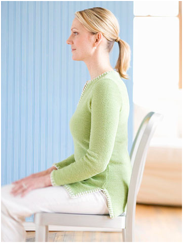 9 Top Tips to Keep Morning Back Pain Away woman sitting