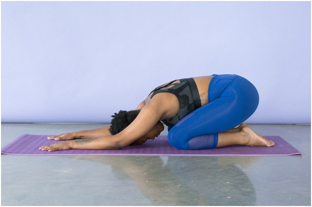 9 Top Tips to Keep Morning Back Pain Away downward dog