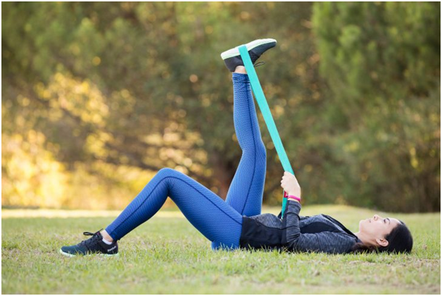 9 Top Tips to Keep Morning Back Pain Away leg band stretch